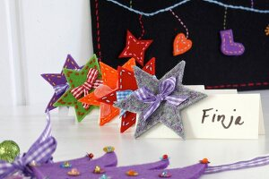 Hand-crafted festive place cards decorated with felt stars & ribbons
