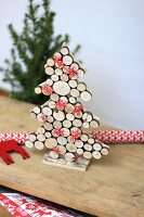 Christmas tree made from discs of wood decorated with garland of moose