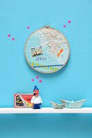 Souvenirs: maps in embroidery hoop decorating wall