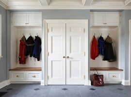Symmetrical, fitted cloakroom in elegant, country-house style
