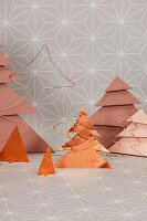 Decorative copper-coloured Christmas trees made from paper, wire and metal foil