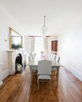 Antique furniture, fireplace and old wooden floor in luxurious dining room