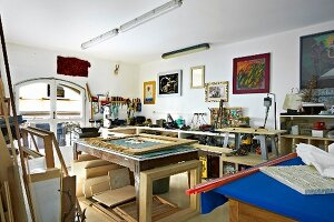 Various shelves and materials in artist's workshop