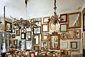 Various picture and mirror frames in artist's studio