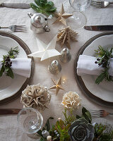Handmade origami Christmas decorations on table