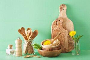 Wooden kitchenware and dandelion flowers