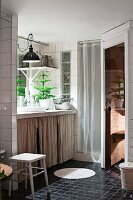 Sauna and curtains on washstand base unit in bathroom