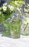 Arrangement of various spring flowers in glass vessels