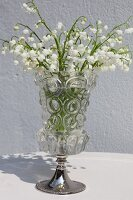 Glass vase of lily of the valley