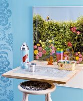 Picture of garden on top of fold-down table with wooden stool