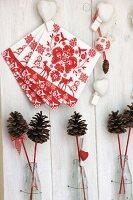 Festive arrangement of napkins, love-hearts & pine cones