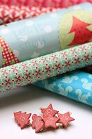 Rolls of various wrapping papers and pegs with numbers for DIY Advent calender