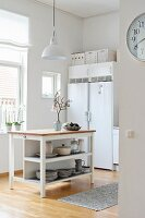 Island counter and side-by-side fridge-freezer in bright kitchen