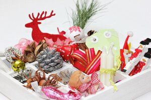 Christmas decorations in white display case