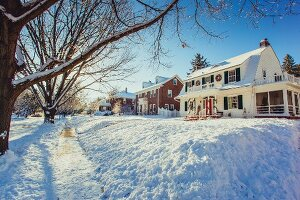 American country houses in snowy landscape