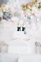 Place setting with name card on wedding table outdoors