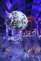Romantic bouquet of roses on wedding table at twilight