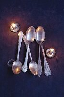 Old silver spoons, florists wire and Christmas tree candle holders for crafting