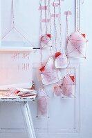 A homemade Advent calendar made with paper houses