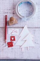 Stamp, sticky tape, stencils and a pencil for crafting