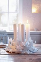 A white Advent wreath made from paper chains
