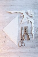A filigree paper star being cut out