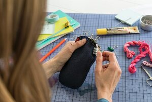 A purse frame being attached to a glasses case