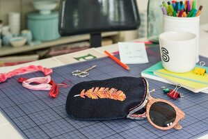 An embroidered glasses case