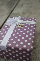 Wrapped gift with ribbon and hand-made gift tag
