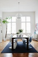 Panton chairs and oak parquet floor in dining room of period apartment