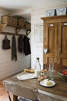 Breakfast ingredients on table in rustic interior with French atmosphere