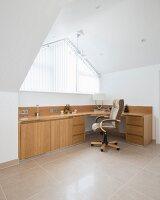 Large desk in modern attic office