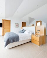 Bed with partition wall at head end