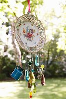 Wind chime hand crafted from old plate and glass beads