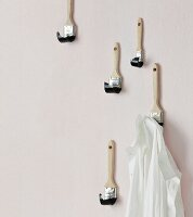 Coat hooks hand-made from paintbrushes
