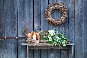 A cornucopia on an old jute sack of lisianthus flowers and coral rose sprigs