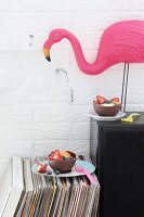 Chocolate bowls made using balloons: edible party bowls of fruit and flamingo ornament on top of speaker