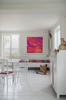 White wooden furniture in rustic interior with white wooden floor