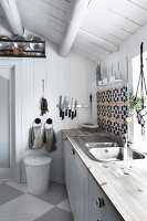 White vintage kitchen in Scandinavian log cabin
