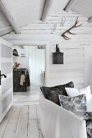 View into Scandinavian log cabin through panelled door