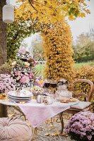 Romantically set table in autumnal garden