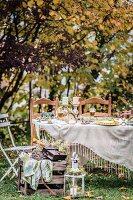 Festively set table in autumnal garden