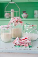Storage jars with hand-made vintage-style cloth lid covers