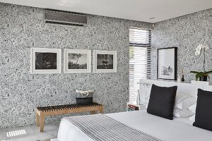 Elegant bedroom with patterned wallpaper and black and white colour scheme