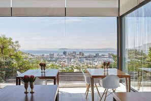 Elegant hotel café with panoramic view of Cape Town and the sea