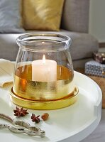 DIY – a glass container decorated with gold leaf as a candle holder