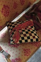 Checked cushion with lobster motif