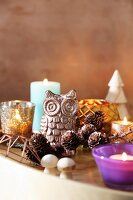 Owl ornament, larch cones, candles and tealight holders