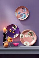 Old decorative wall plates revamped with paint