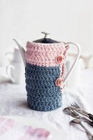 Crocheted cosy in pink and grey-blue on vintage coffee pot